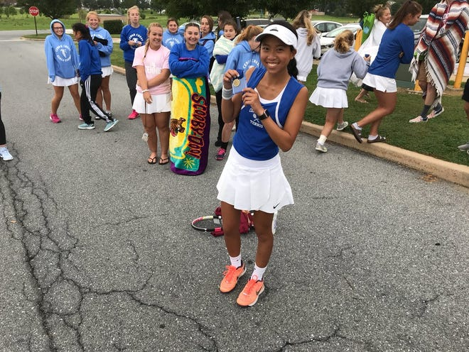 Cedar Crest's Serena Cheng shows off her medal and a wide smile after winning the Lebanon County singles title in September and helping the Falcons to a fourth straight county team title.