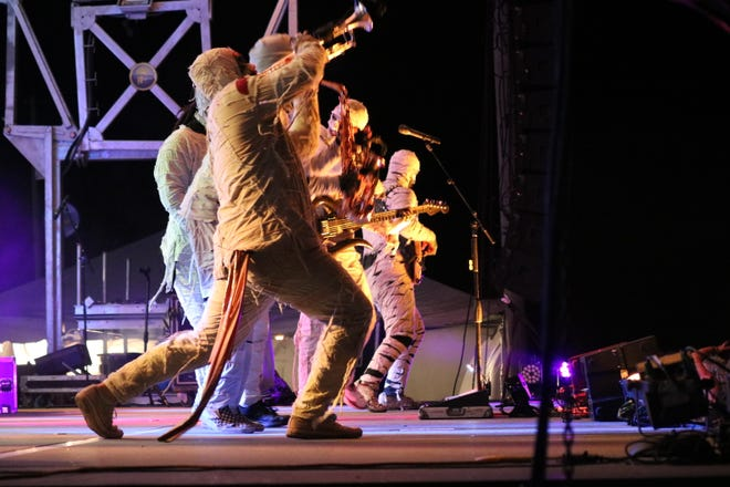 "Here Come The Mummies, an eight-piece undead funk band, got busy with hundreds at the first ""Rock the Light"" Music Festival on Friday night."