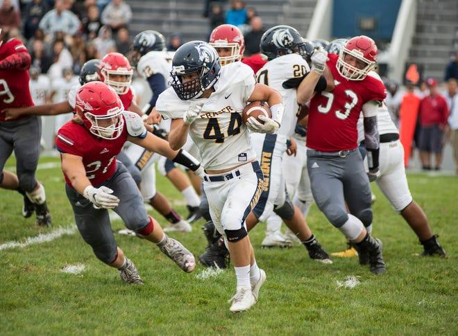 Fraser High School running back Jacob Brusinski (44) runs around players from Port Huron High School during their football game Friday, Sept. 7, 2018 at Memorial Stadium.