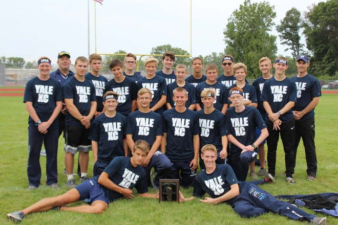 The Yale High School cross country team poses for a photo after winning the Algonac Muskrat Classic Saturday at  Algonac High School