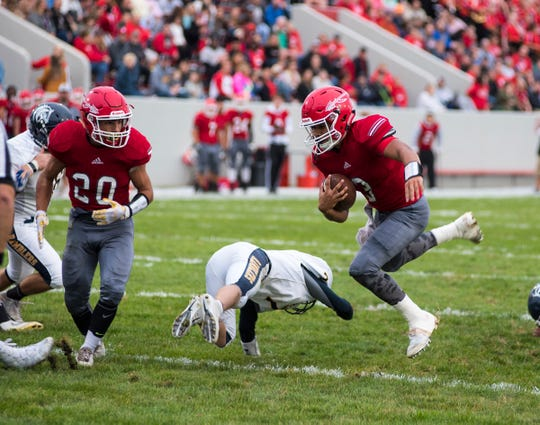 Port Huron High School quarterback Jonny Oriel carries the football into the end zone for a touchdown Friday, Sept. 7, 2018 at Memorial Stadium. Oriel's touchdown brought Port Huron up 14-0.