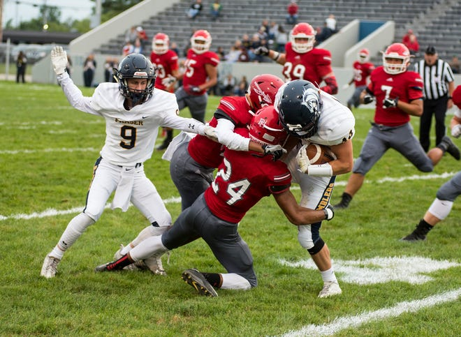 Fraser High School running back Jacob Brusinski (44) is brought down by players from Port Huron High School during their game Friday, Sept. 7, 2018 at Memorial Stadium.