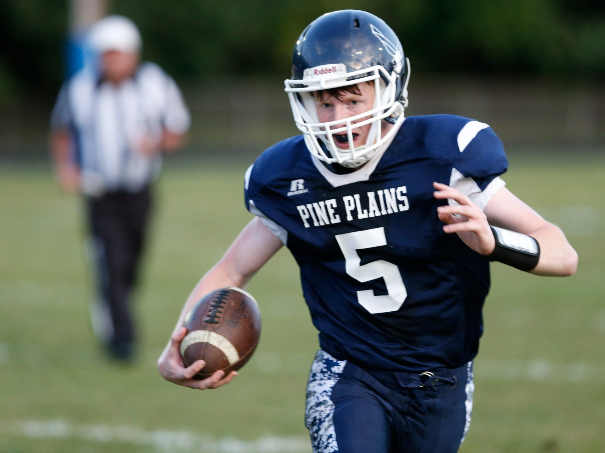Pine Plains' Andrew Holsopple carries the ball for a gain in the first quarter of Friday's home game versus Roscoe on September 7, 2018.