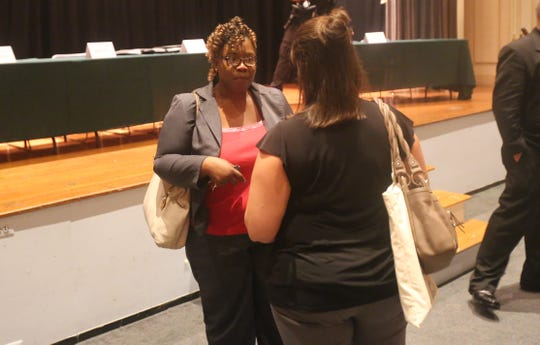 Kenya Gadsden, of Fishkill, speaks with state assembly candidate Jodi McCredo after a forum in the City of Poughkeepsie on Thursday. She said the candidates spoke about many issues important to her.