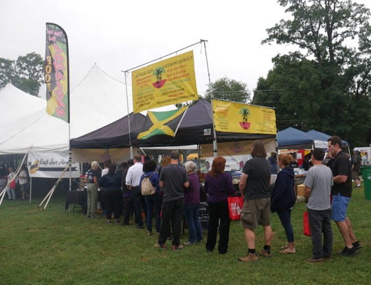 Hudson Valley Wine & Food Fest attendees line up to get Jamaican food at Reggae Boy on Sept. 8, 2018.