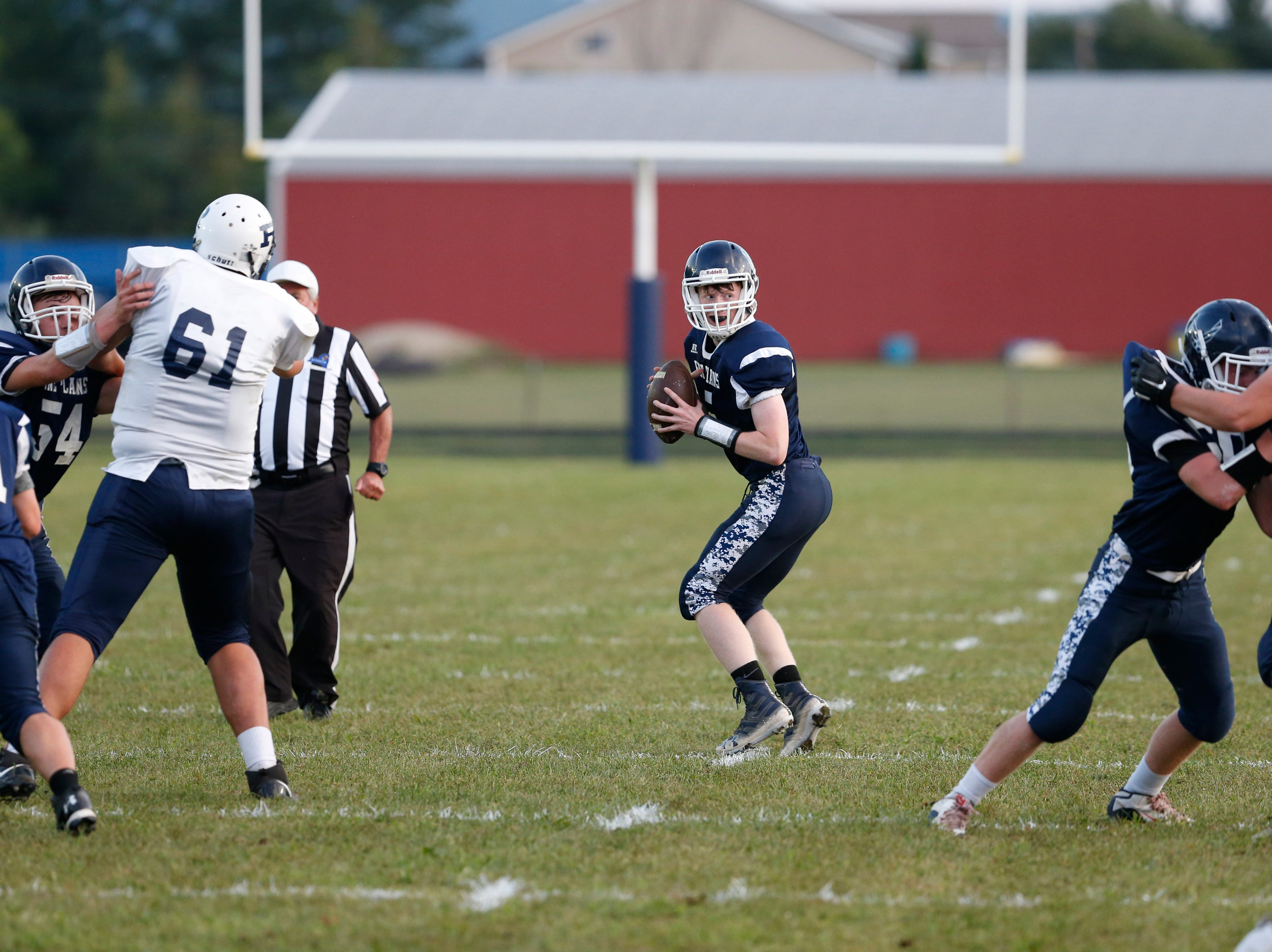 Pine Plains' Andrew Holsopple searches for an open receiver during Friday's home gam versus Roscoe on September 7, 2018.