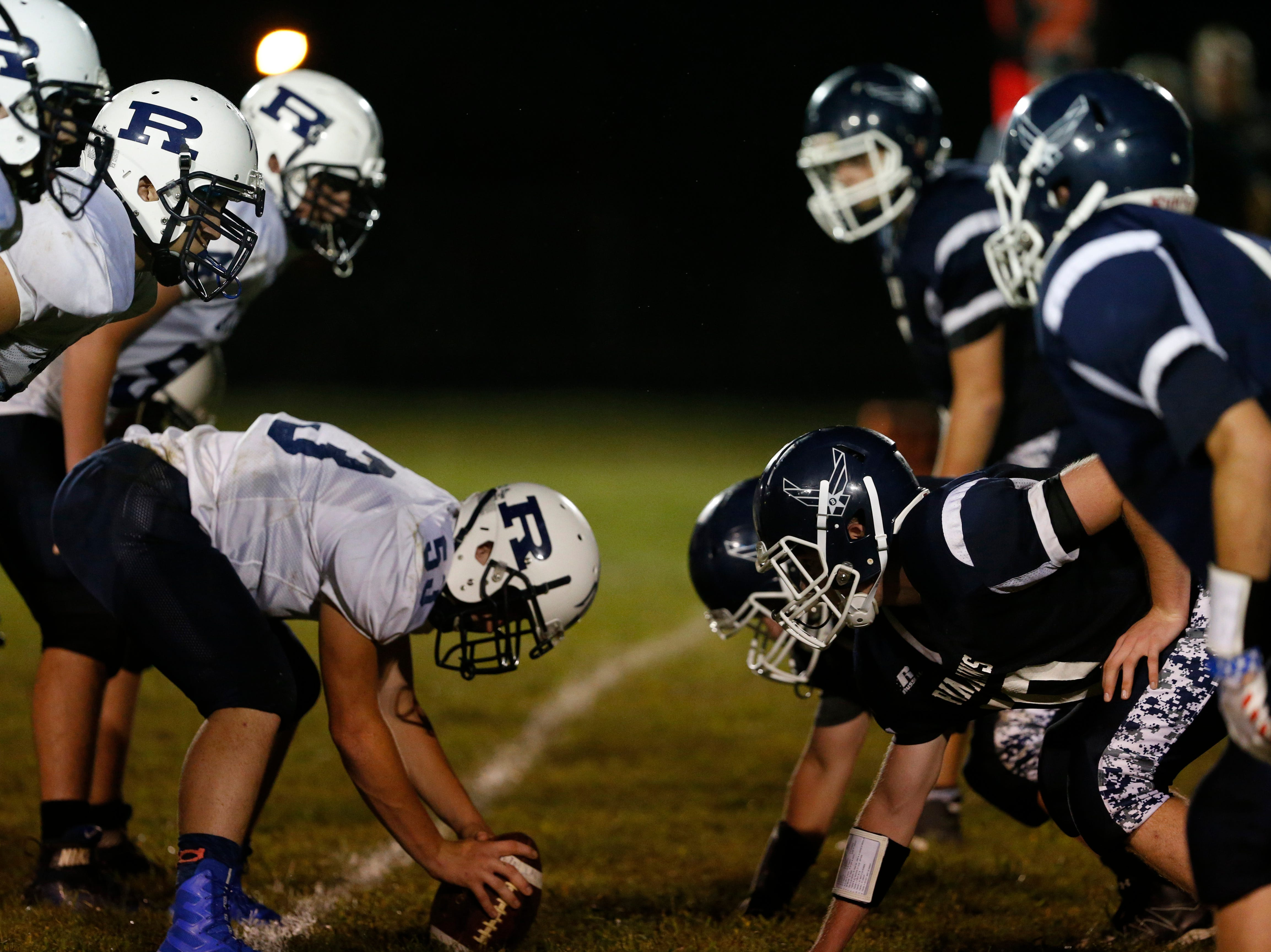 The Roscoe (left) and Pine Plains offensive lines ready for a snap at the line of scrimmage during an eight-man football game on Friday.
