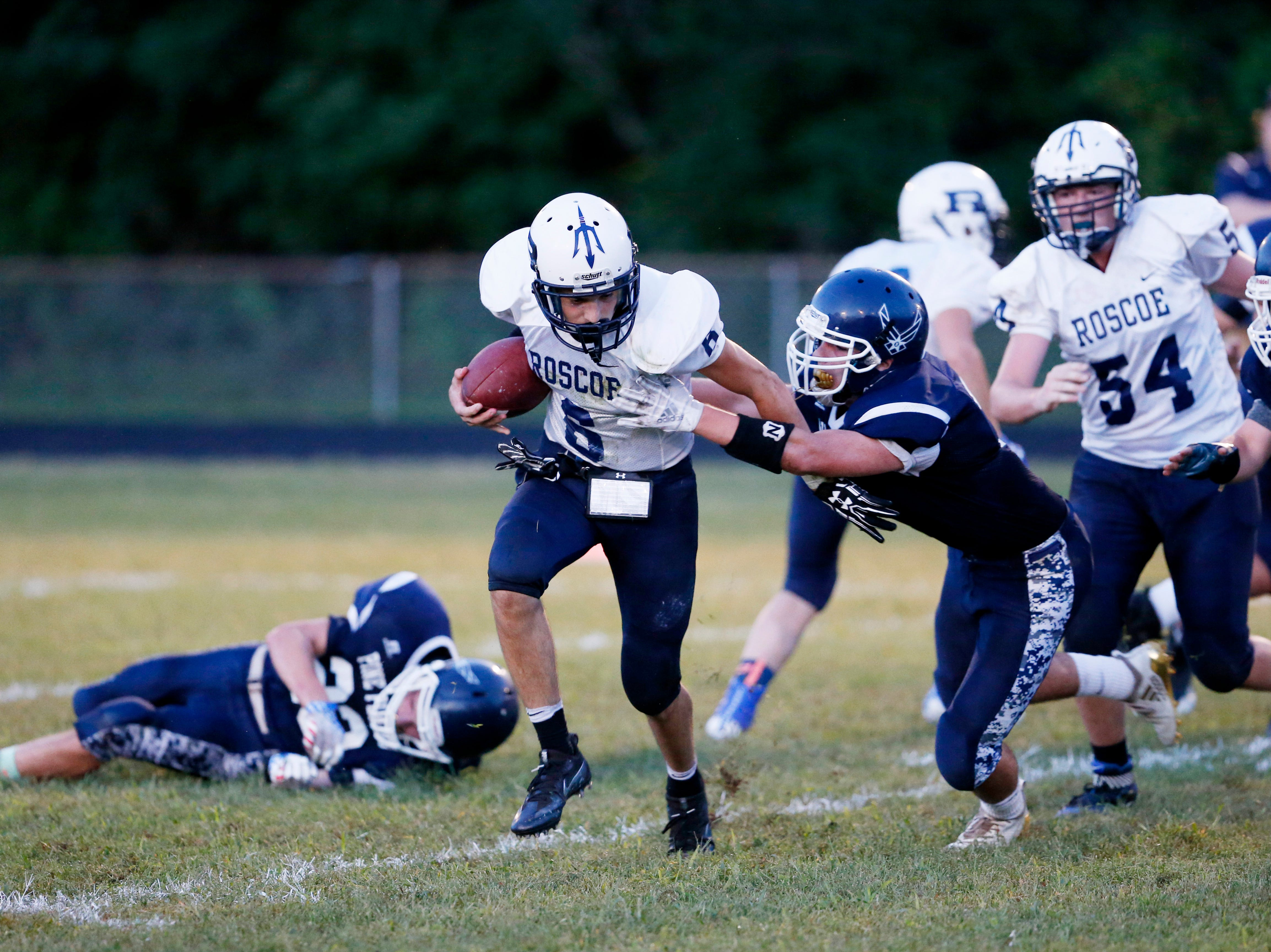 Roscoe's Erick Hill attempts to break free from Pine Plains' Evan Proper during Friday's game at Stissing Mountain High School on September 7, 2018.