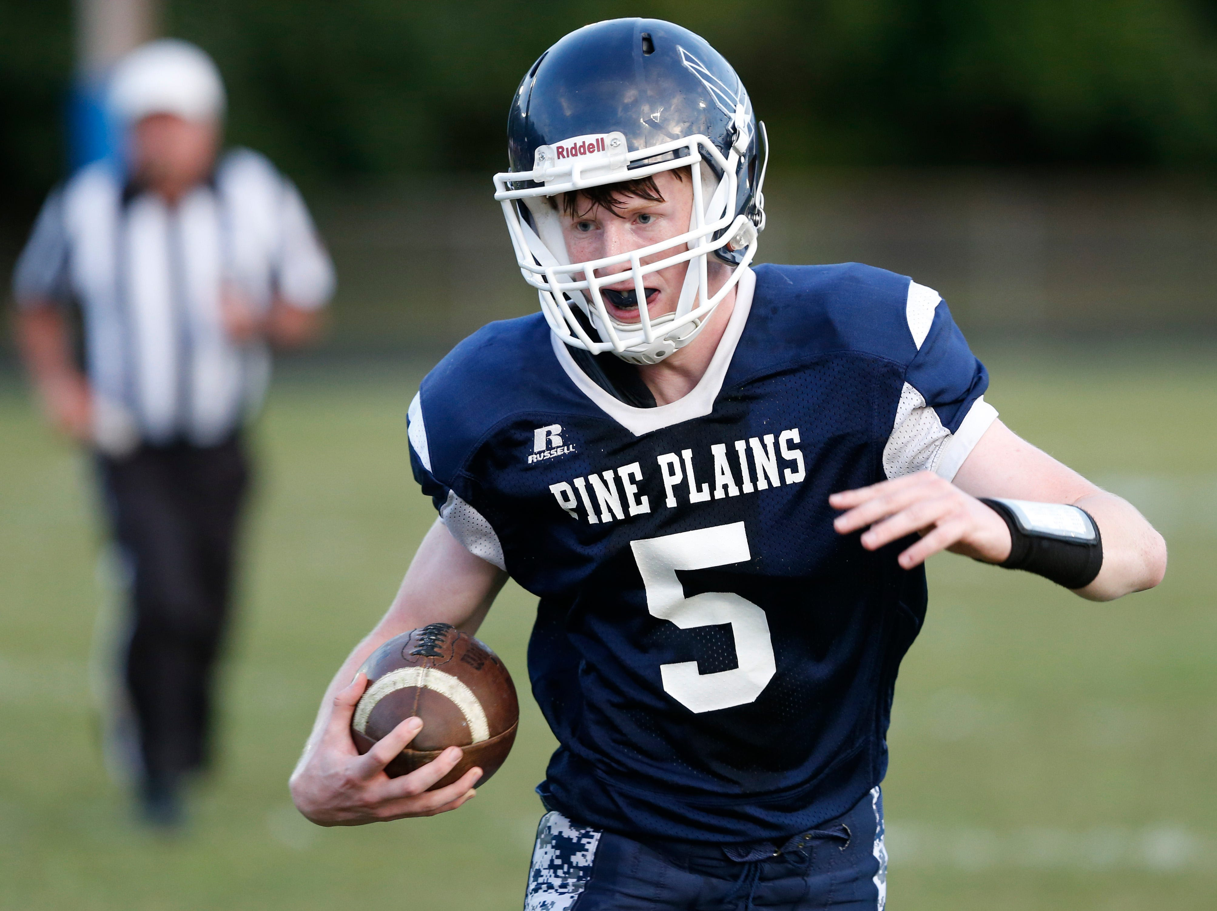 Pine Plains' Andrew Holsopple carries the ball during Friday's home gam versus Roscoe on September 7, 2018.