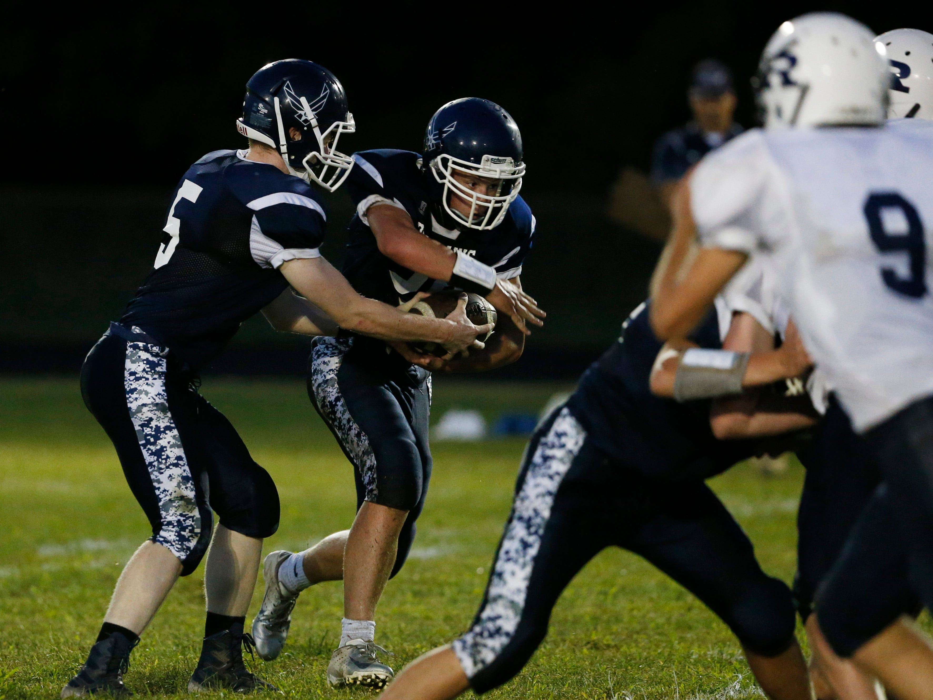 Pine Plains's Andrew Holsopple fakes a hand off to Michael Kelly during Friday's game versus Roscoe at Stissing Mountain High School on September 7, 2018.
