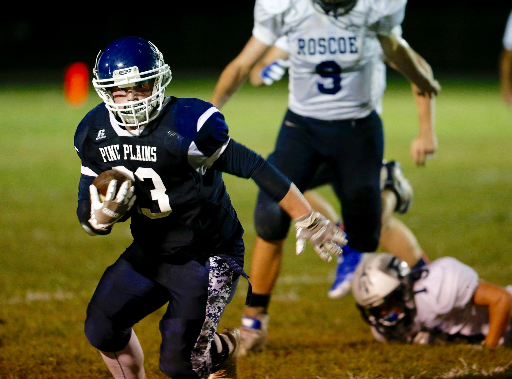 Pine Plains' Kyle Stracher carries the ball for a gain during the second quarter of Friday's home game versus Roscoe on September 7, 2018.