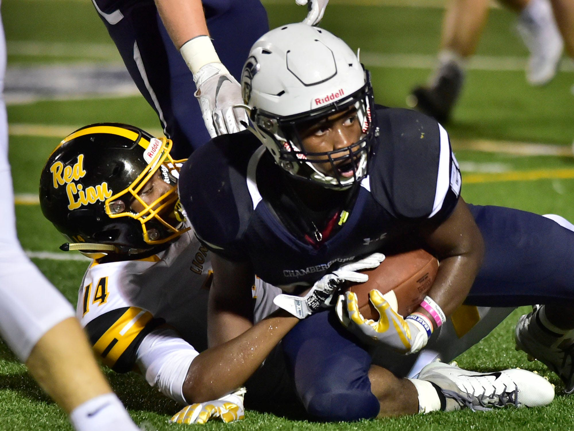 Chambersburg's Keyshawn Jones is brought down by Red Lion's Kobe Martin after a first down. Chambersburg defeated Red Lion 28-19 in PIAA football on Friday, Sept. 7, 2018.
