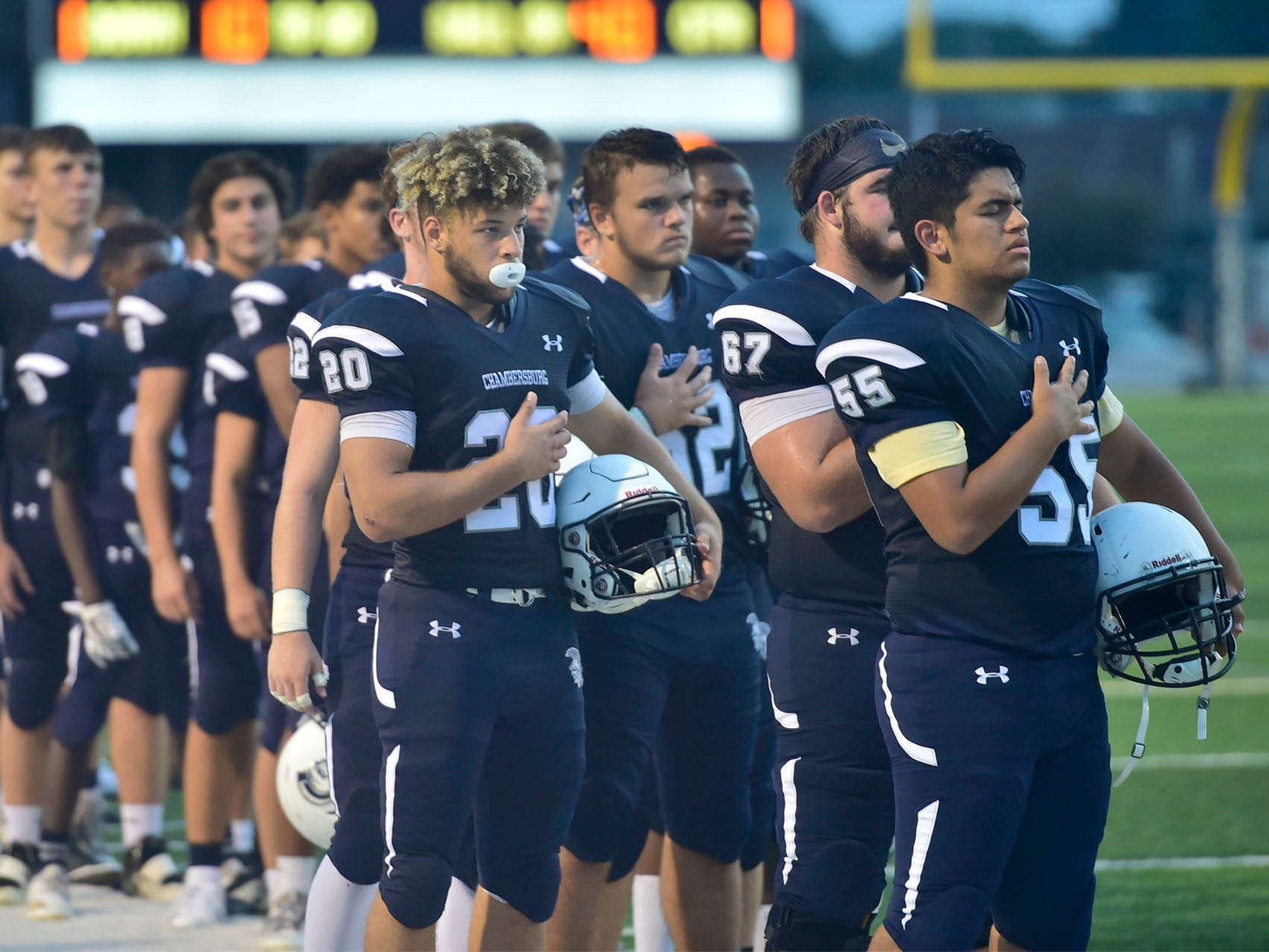 Chambersburg players stand for the National Anthem. Chambersburg defeated Red Lion 28-19 in PIAA football on Friday, Sept. 7, 2018.