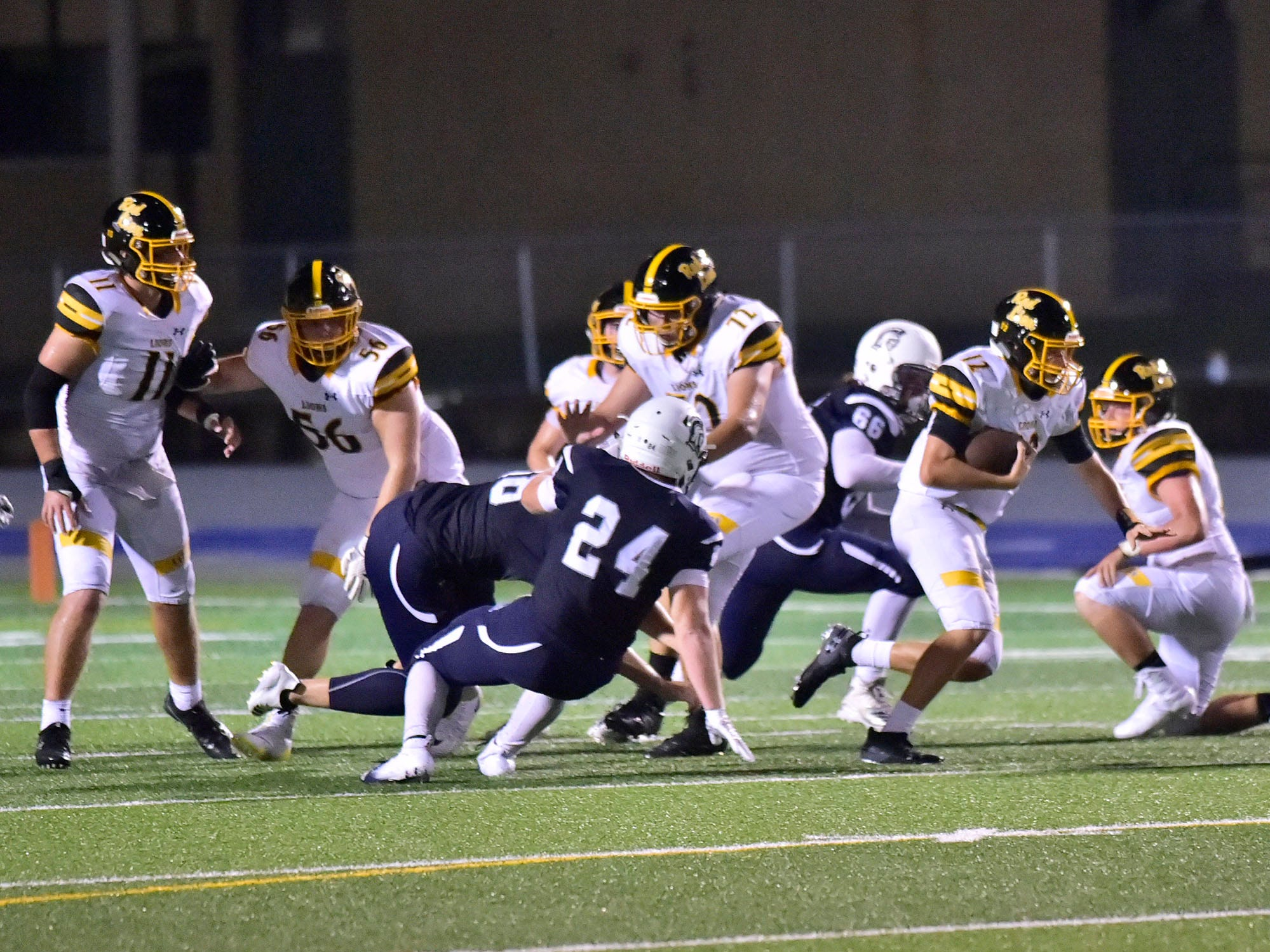 QB Zach Mentzer (12) is on the run for Red Lion. Chambersburg defeated Red Lion 28-19 in PIAA football on Friday, Sept. 7, 2018.