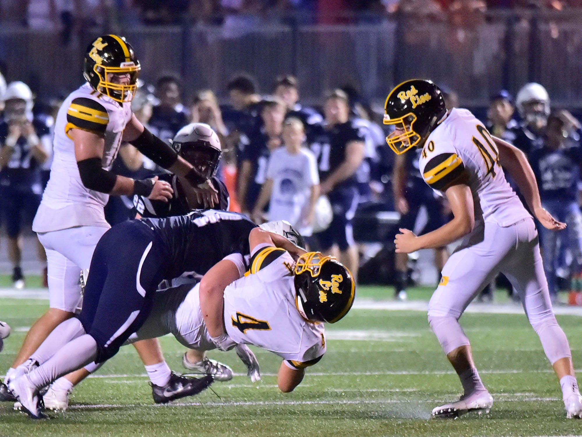 Red Lion's (4) is tackled by Chambersburg defenders. Chambersburg defeated Red Lion 28-19 in PIAA football on Friday, Sept. 7, 2018.
