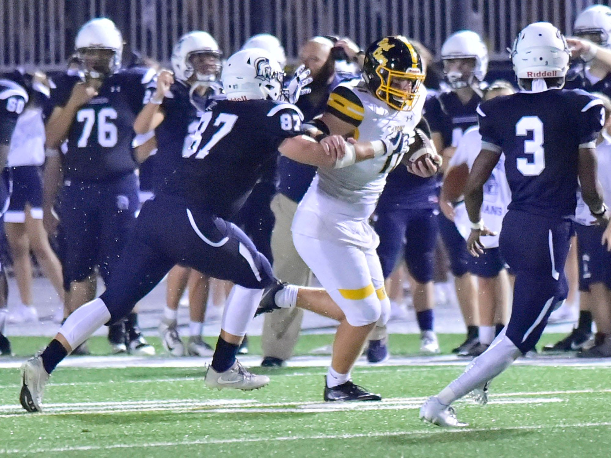 Red Lion's Elijah Workinger (11) is in the grasp of Bryce Diller (87) of Chambersburg. Chambersburg defeated Red Lion 28-19 in PIAA football on Friday, Sept. 7, 2018.