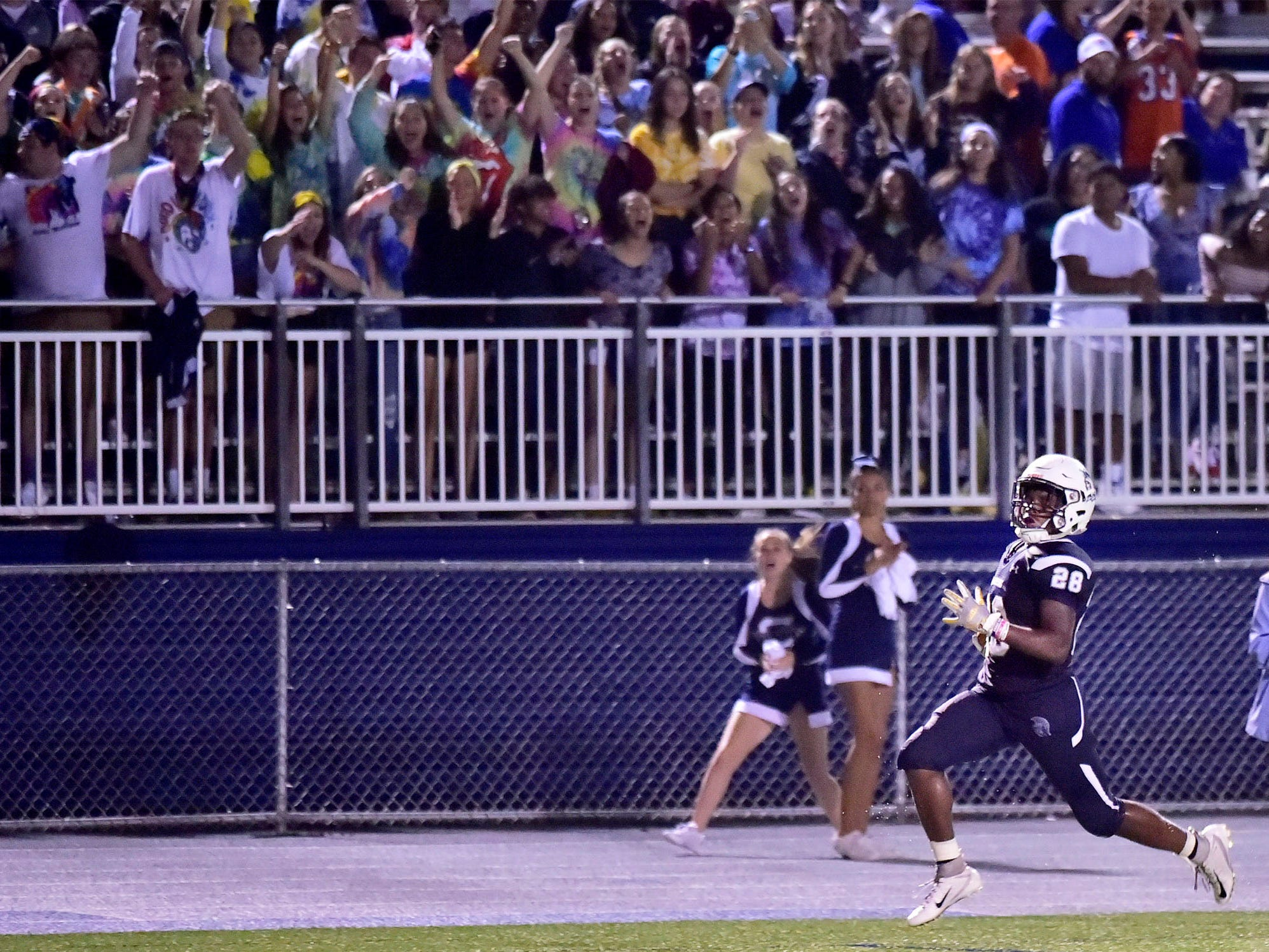Fans react a Chambersburg's Keyshawn Jones takes the ball to the end zone. Chambersburg defeated Red Lion 28-19 in PIAA football on Friday, Sept. 7, 2018.