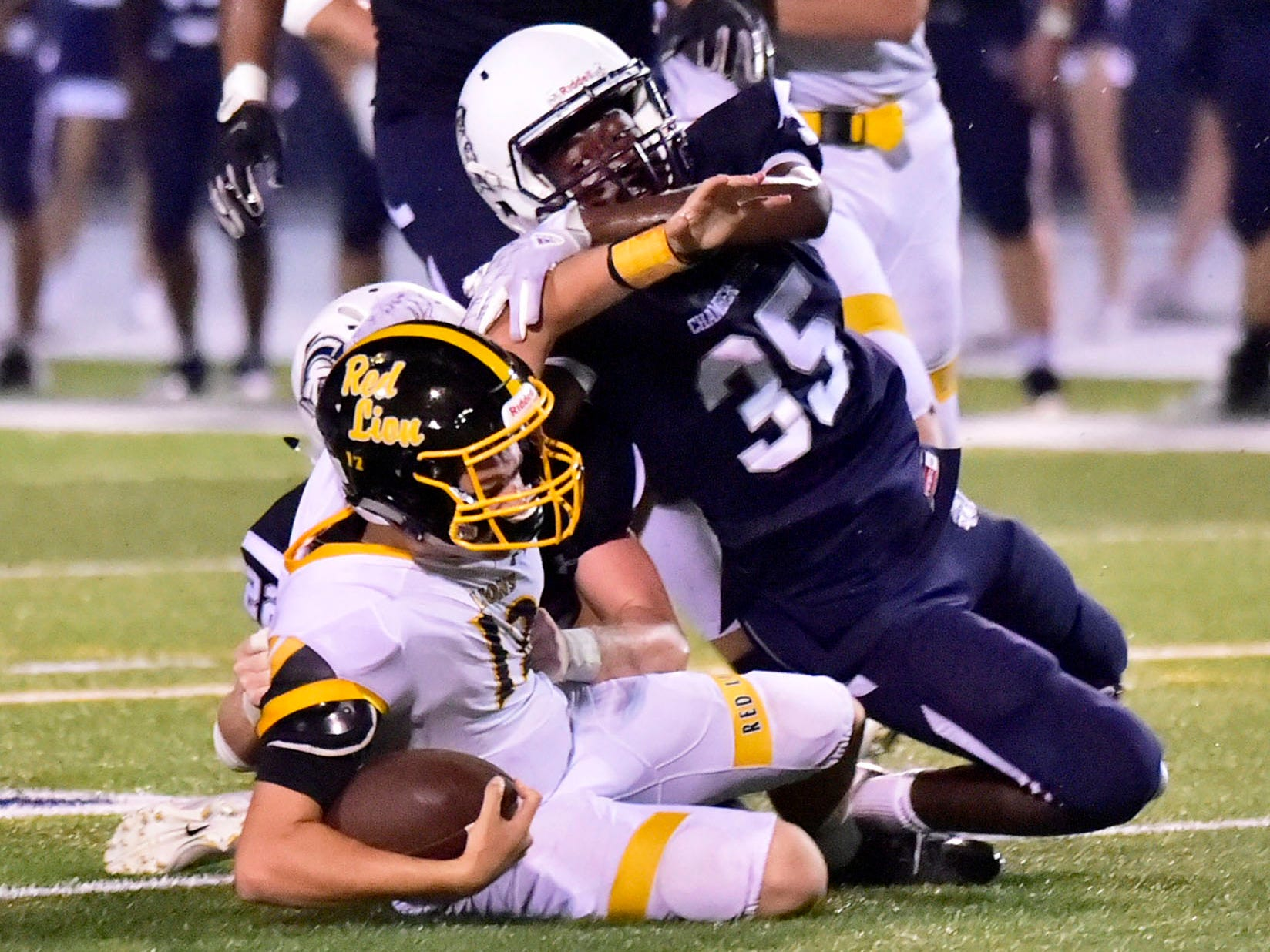 Chambersburg's DaQuan Rogers (35) brings down Red Lion QB Zach Mentzer (12) Chambersburg defeated Red Lion 28-19 in PIAA football on Friday, Sept. 7, 2018.