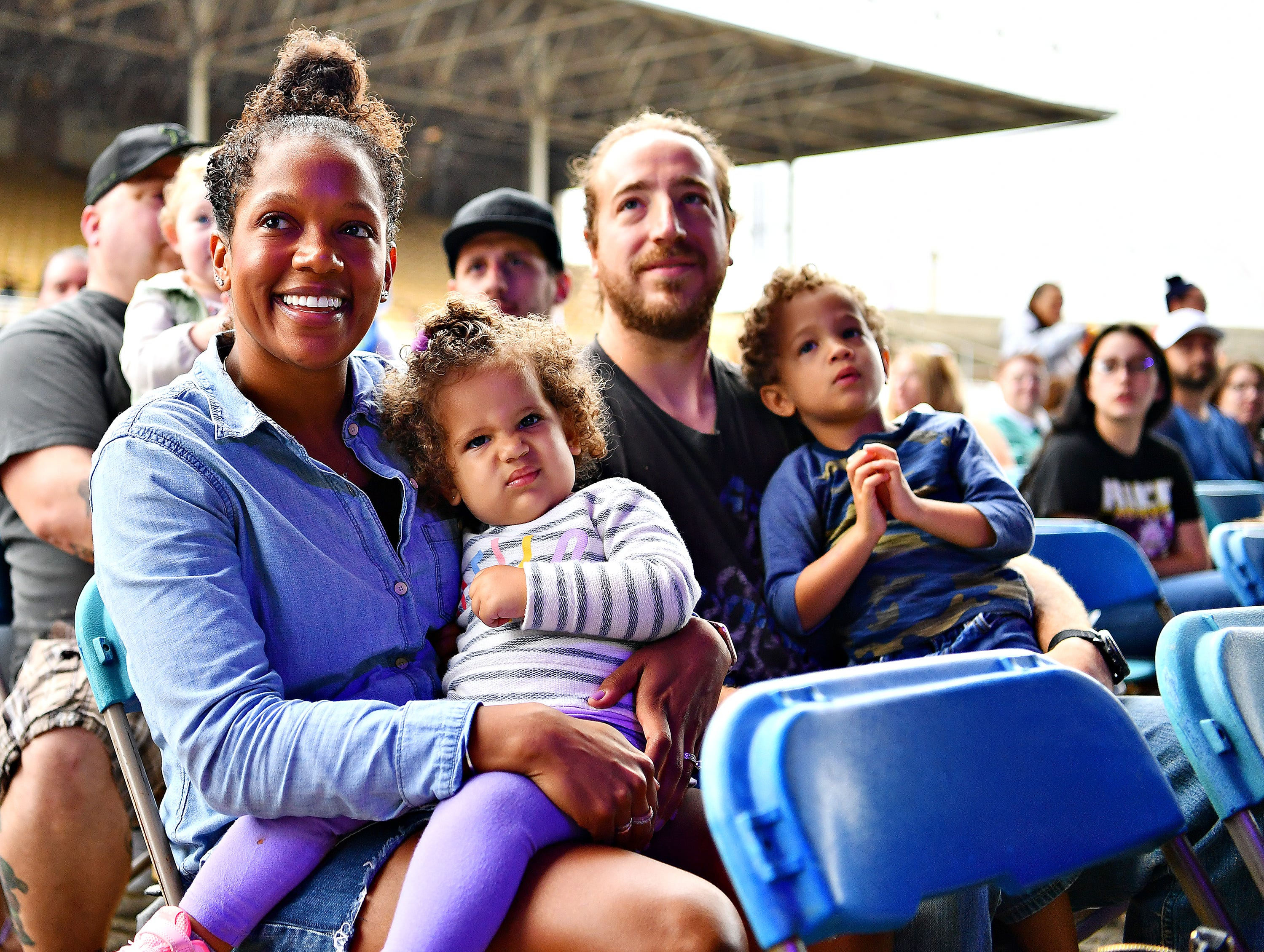 From left, Niki Raves, Rayna Raves, 1, Ryan Raves, and Jameson Raves, 3, all of New Bloomsfield in Perry County, look on during the early performance of Sesame Street Live at York Fair, Saturday, Sept. 8, 2018. Dawn J. Sagert photo
