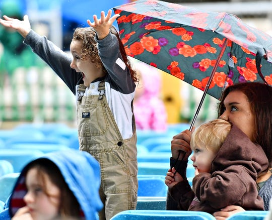 From right, Briana Goodrich, of Dallastown, holds Jasper Wire, 2, of Manchester Township, while she watches her son Bradley Weber, 3, sing and dance during the early performance of Sesame Street Live at York Fair, Saturday, Sept. 8, 2018. Dawn J. Sagert photo