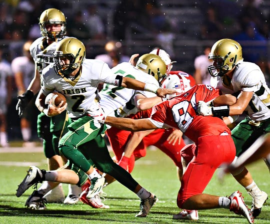 York Catholic senior running back Massimo Antolick, shown here running the ball in a game earlier this season, will be one of 31 seniors between both the Irish and the Squires in the District 3 Class 2-A title game Friday. DISPATCH FILE PHOTO.