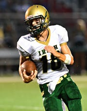 York Catholic quarterback Wesley Burns, shown here in a game earlier this season, hopes to lead the Irish, along with sophomore QB Mitchell Galentine, to a title-deciding win over Delone Friday. DISPATCH FILE PHOTO.