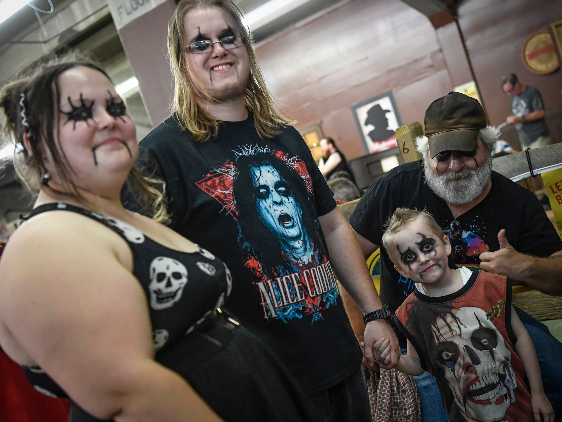 Three generations of Alice Cooper fans, Haylei Hebert, left of York, Matthew Yeager, Sebastian Strayer, 5, and grandfather Dave Warner, all of Harrisburg, wait in line to get into the York Fair Grandstand stage, Friday, September 7, 2018.