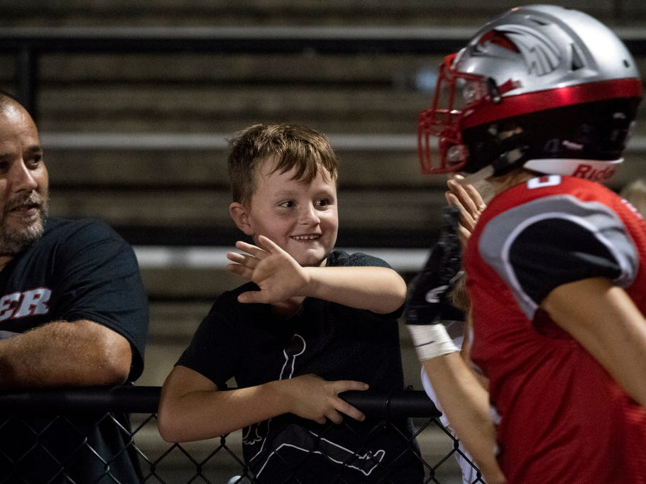 A young boy waits for high fives after the Dover Eagles' win, Friday, September 7, 2018. The Dover Eagles beat the Red Land Patriots, 35-13, at Dover High School. N