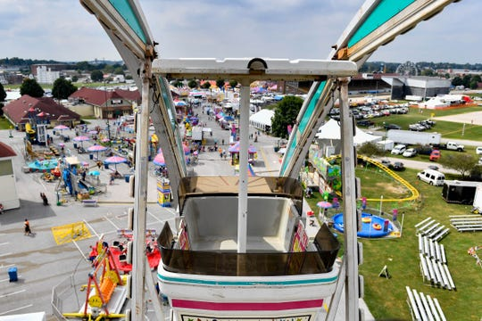 Two towering Ferris wheels provide unparalleled vantage points at the York Fair.