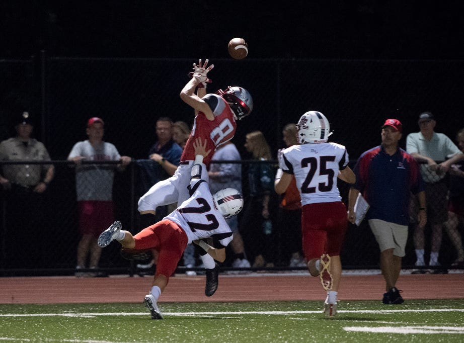 Dover's Shaun Hinkle (8) leaps up to attempt a catch, Friday, September 7, 2018. The Dover Eagles beat the Red Land Patriots, 35-13, at Dover High School.