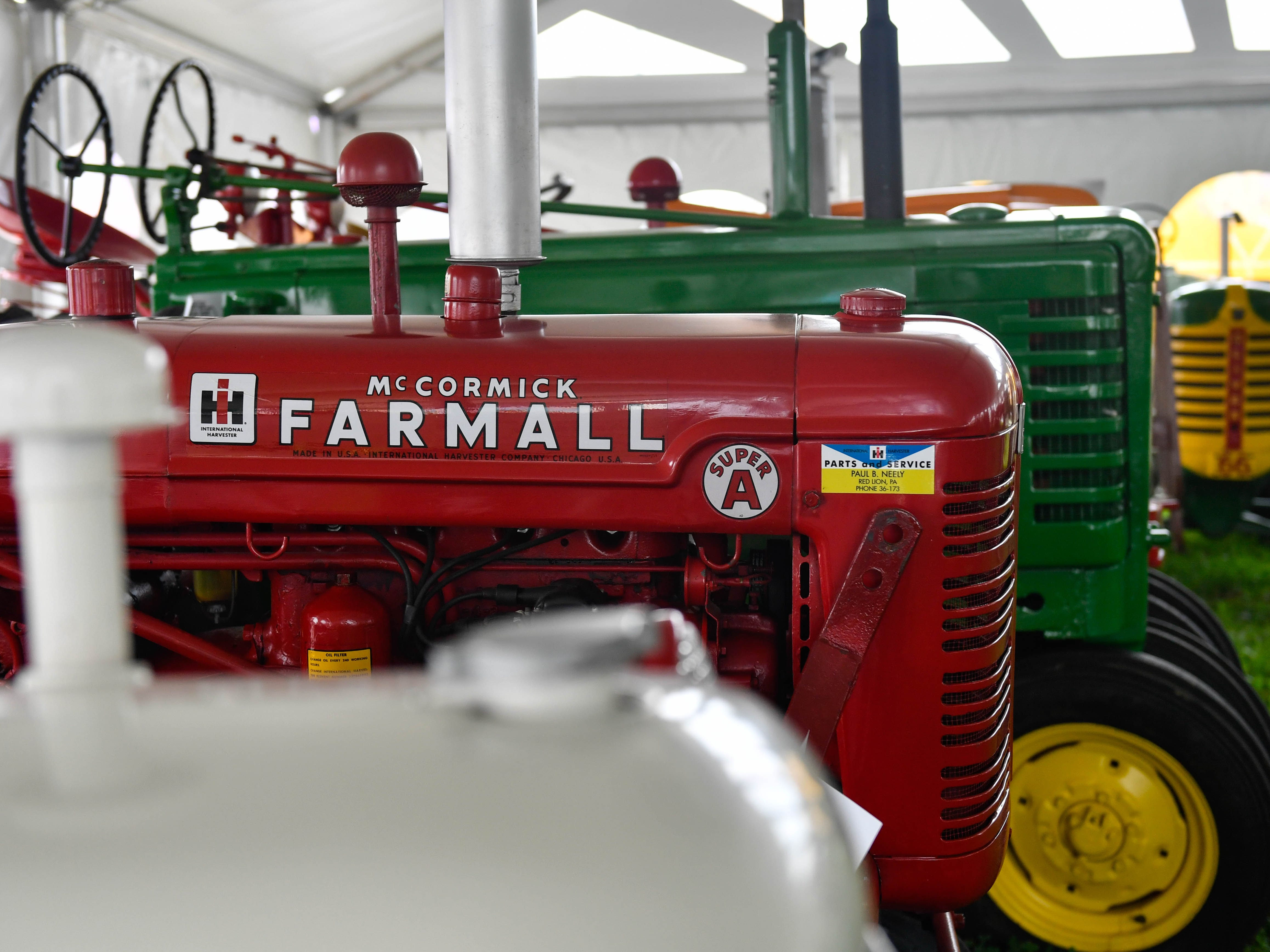 A tent dedicated to vintage tractors is just one of the many unique things to see at the York Fair, Friday, September 7, 2018.