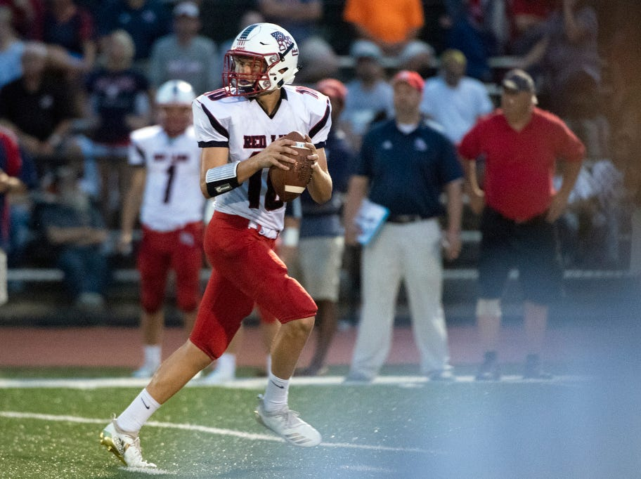 Red Land quarterback Adam Cramer (10) drops back to look for a pass, Friday, September 7, 2018. The Dover Eagles beat the Red Land Patriots, 35-13, at Dover High School.