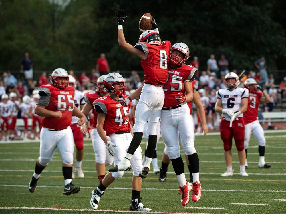 Shaun Hinkle (8) celebrates his touchdown with teammate Carson Snelbaker (25) in the first quarter, Friday, September 7, 2018. The Dover Eagles beat the Red Land Patriots, 35-13, at Dover High School.