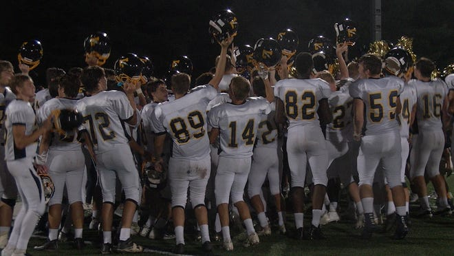 The Littlestown football team celebrates following its 40-14 road win over Eastern York on Friday.