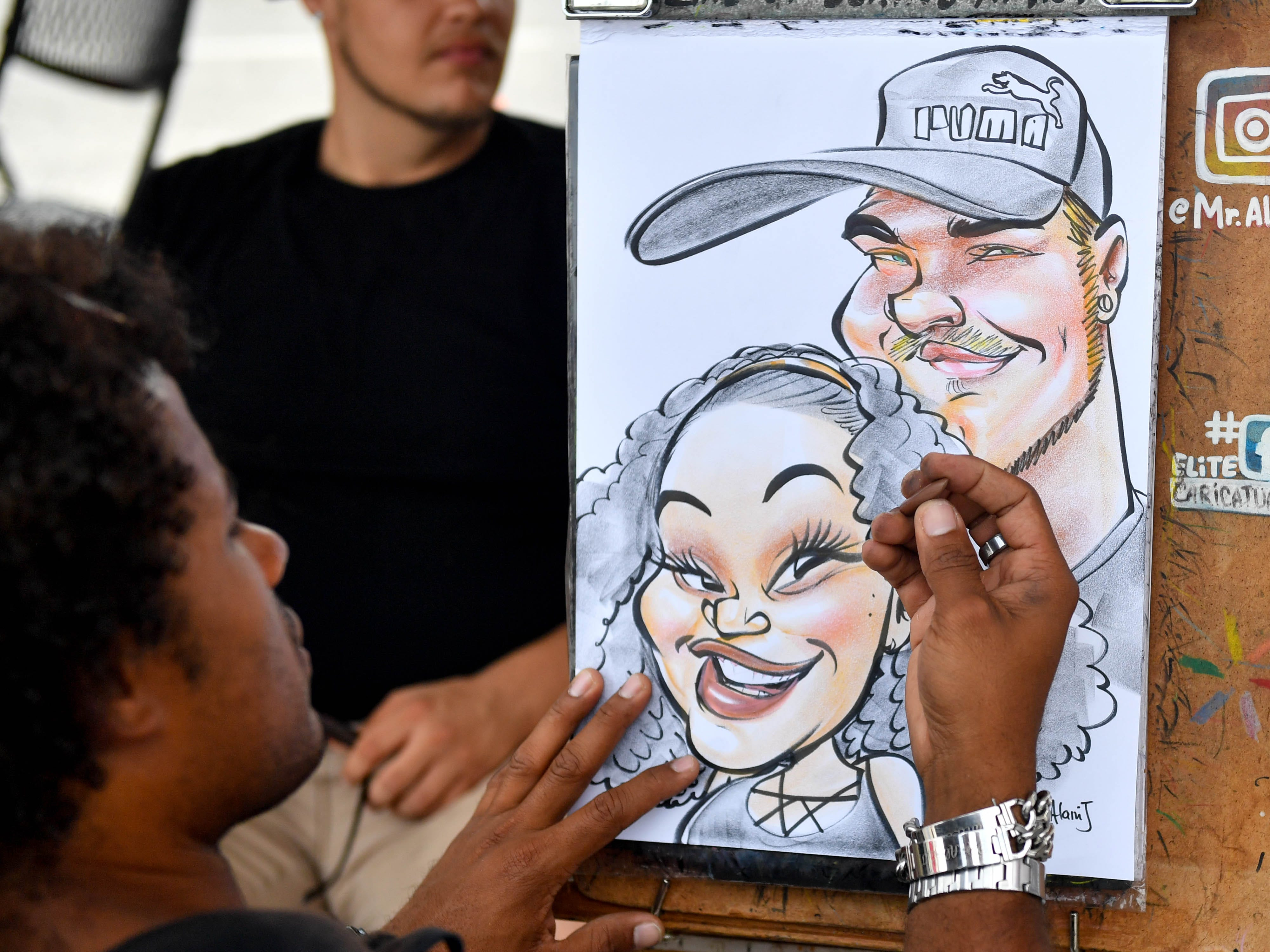 Talented caricature artists are one of the more popular attractions at the York Fair, Friday, September 7, 2018.