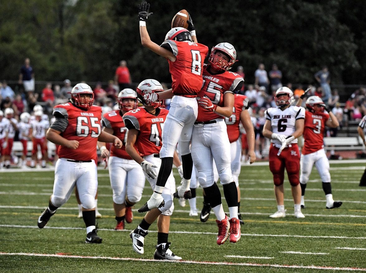 Dover players celebrate a touchdown in the first half Friday against Red Land.