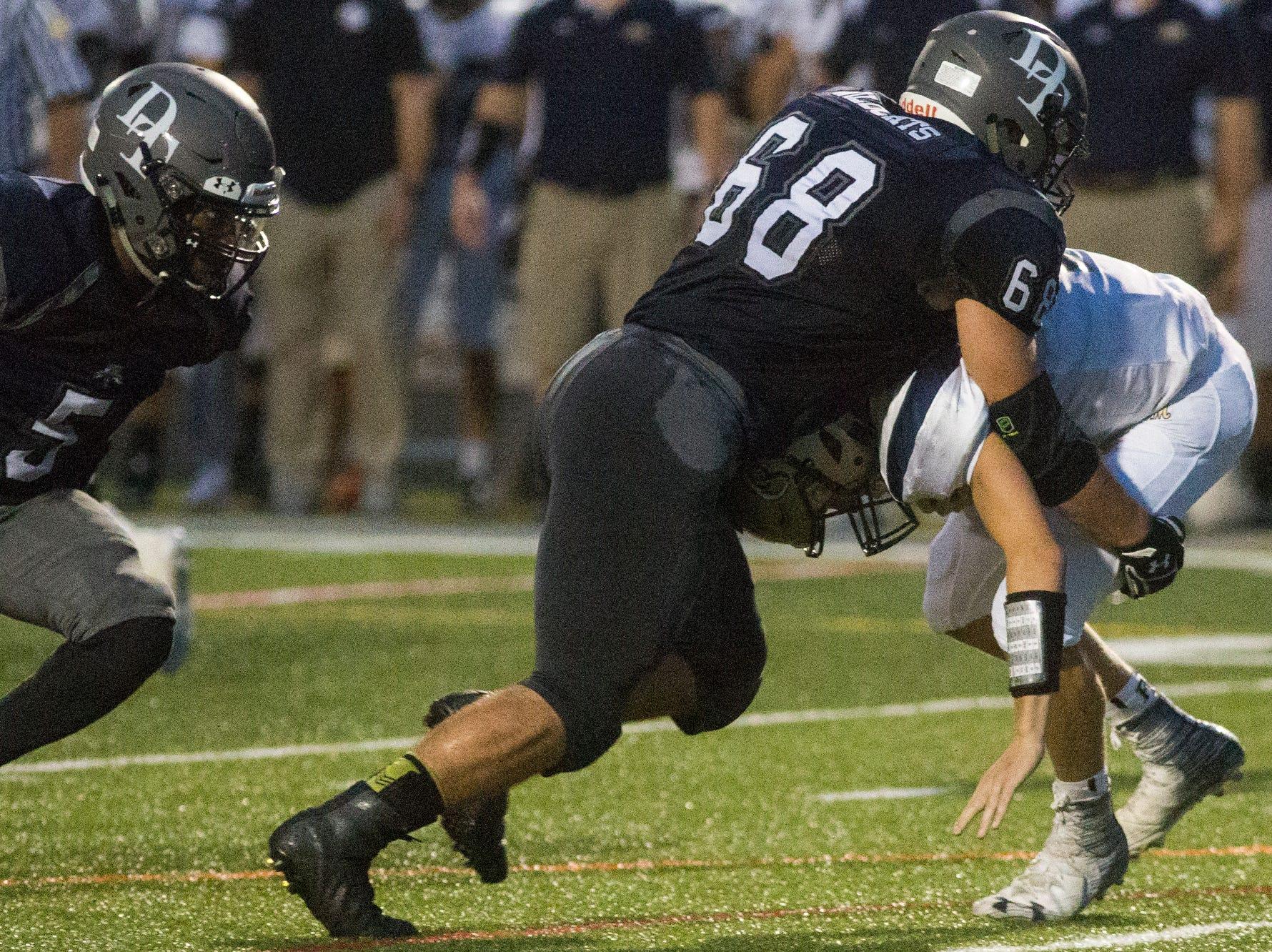 Dallastown's Noah Strine sacks Penn Manor quarterback Aaron Gale. Dallastown defeats Penn Manor 42-7 in football at Dallastown Area High School in Dallastown, Friday, September 7, 2018.