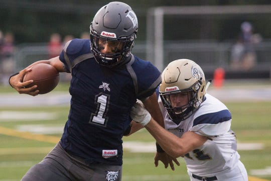 Dallastown quarterback Jordan Cook runs with the ball. Dallastown defeats Penn Manor 42-7 in football at Dallastown Area High School in Dallastown, Friday, September 7, 2018.