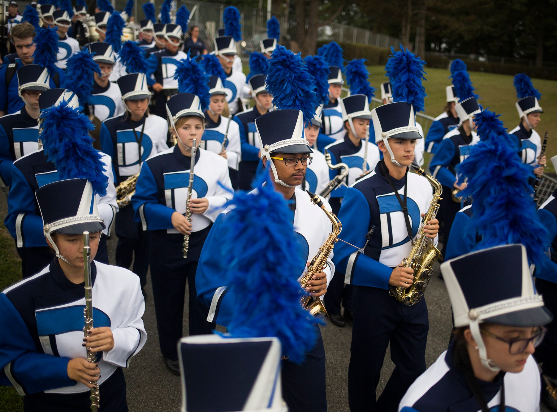 The Dallastown Area High School marching band enters the stadium prior to the game. Dallastown defeats Penn Manor 42-7 in football at Dallastown Area High School in Dallastown, Friday, September 7, 2018.