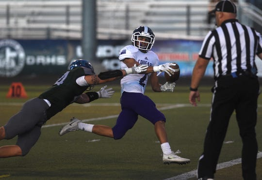 Spanish Springs' Colby Melton (2) scores while taking on Damonte Ranch during their football game in Reno on Sept. 7, 2018.