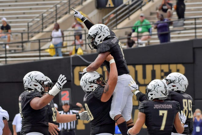 Vanderbilt running back Josh Crawford (6) celebrates with teammates after scoring a touchdown against the Wolf Pack during the second half.