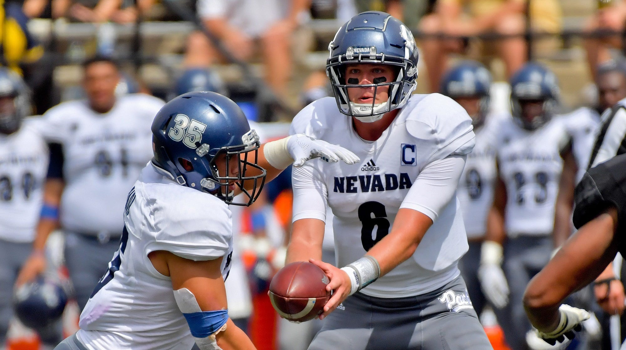 Nevada quarterback Ty Gangi (6) hands off to running back Toa Taua (35) during the second half at Vanderbilt Stadium.