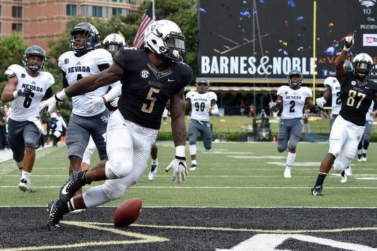 Vanderbilt running back Ke'Shawn Vaughn (5) runs in a touchdown against Nevada during the second half.