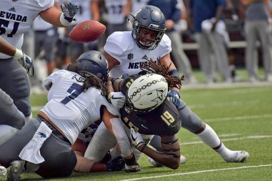 Vanderbilt wide receiver Chris Pierce (19) fumbles the ball against Nevada linebacker Gabriel Sewell (7) during the first half at Vanderbilt Stadium.