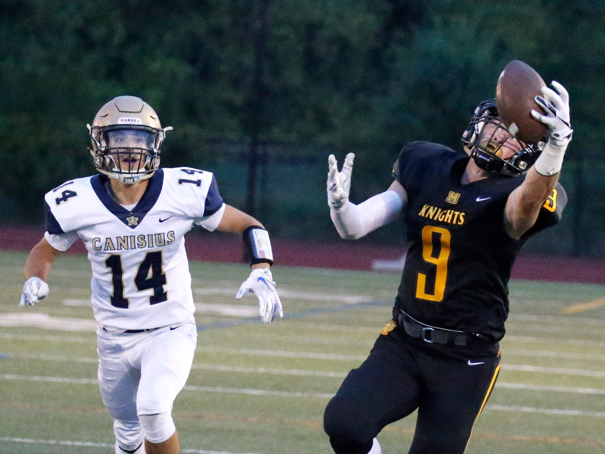McQuaid's Ben Beauchamp catches a pass against Canisius in the first quarter at McQuaid Jesuit High School.