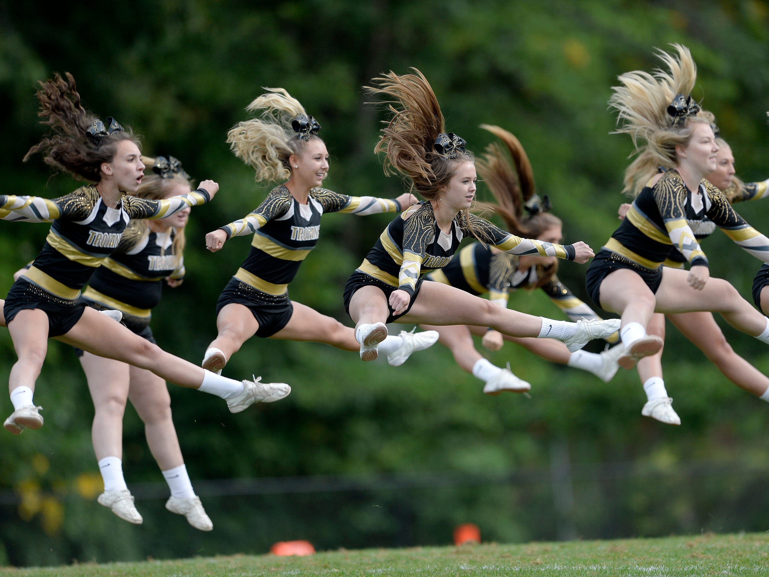 Greece Athena cheerleaders perform a halftime routine during Saturday's game against Irondequoit at Greece Athena High School.
