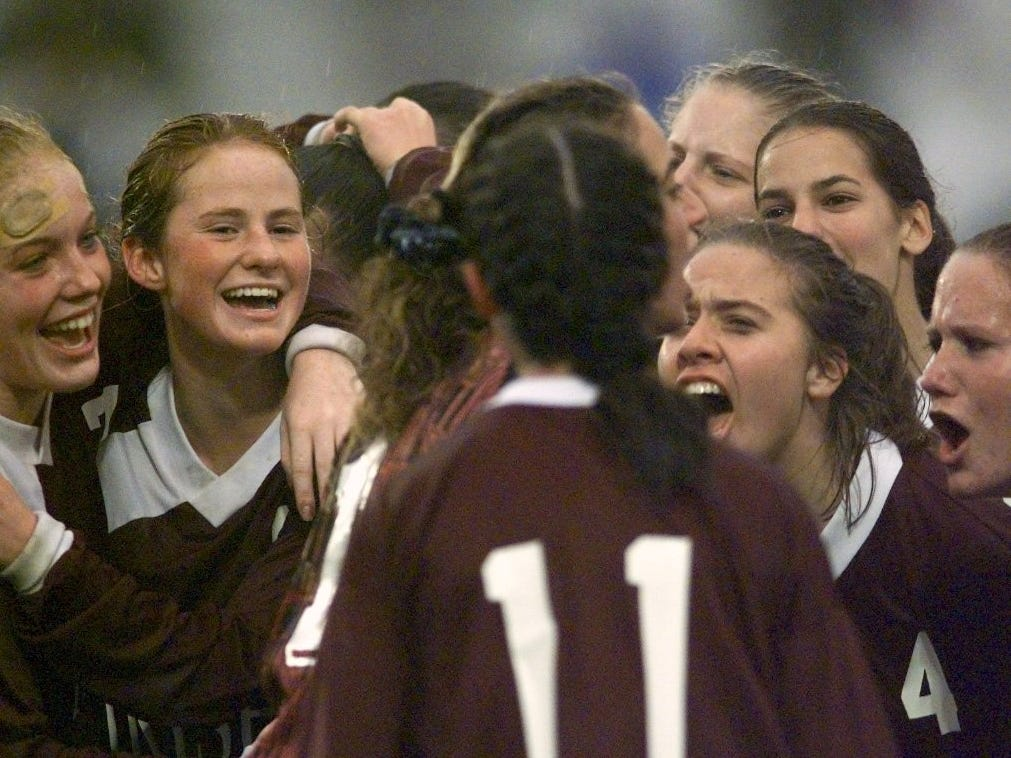 The Aquinas's girls soccer team cheers together after defeating Pittsford Mendon 1-0 to win the Section V Class BB championship on Nov. 1, 1997.
