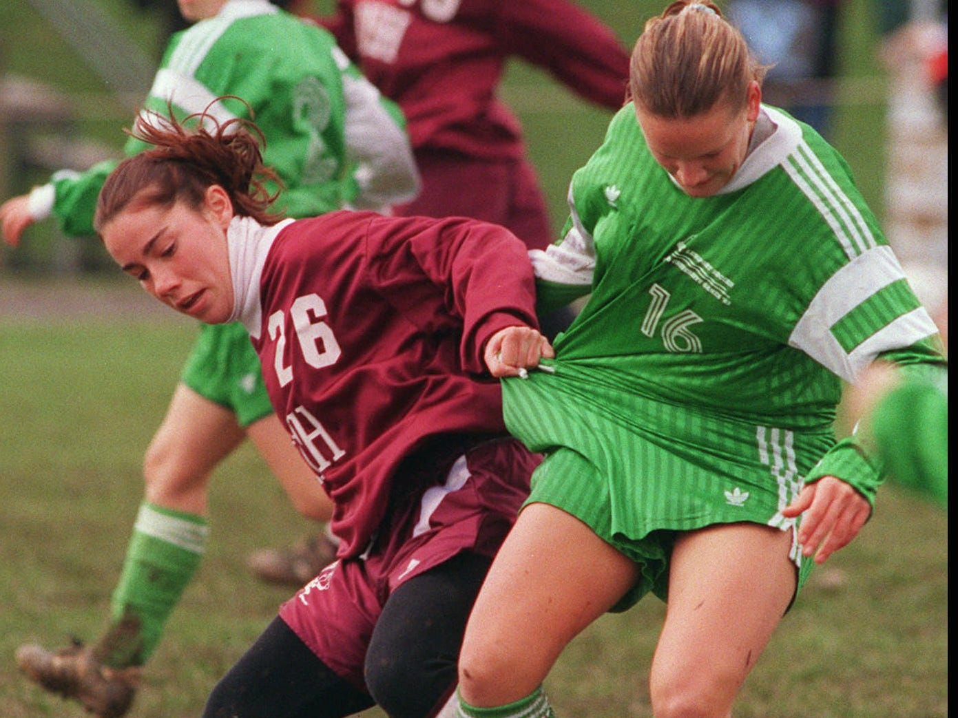 Jessica Parmalee, left, of Aquinas battles Christi Martell of Lewiston-Porter for the ball during a state playoff game on Nov. 9, 1996.