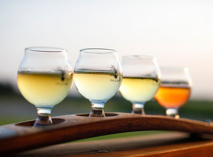 A colorful flight of ciders at Oak & Apple Cidery.