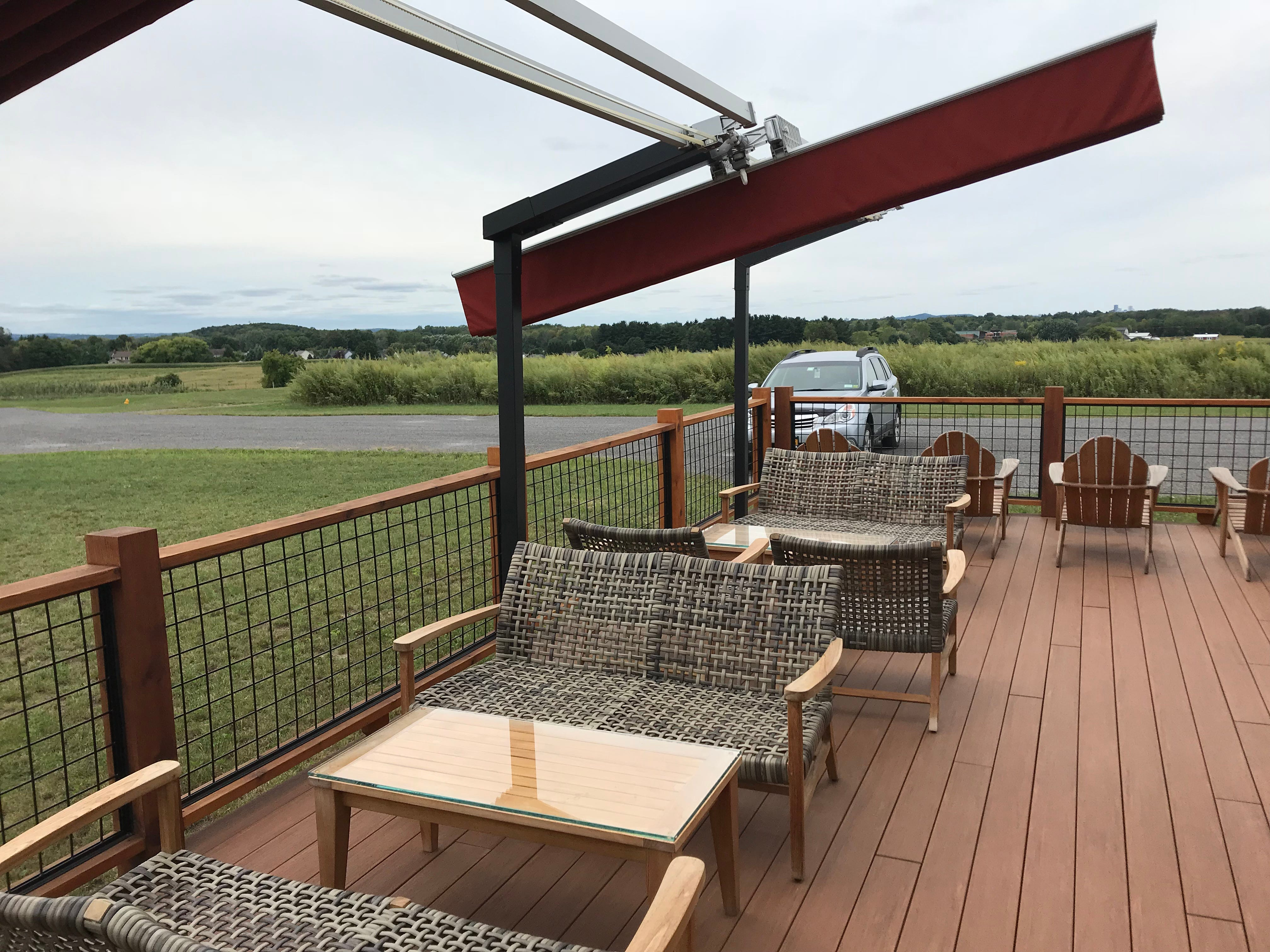 Prime outdoor deck seating at Oak & Apple Cidery.